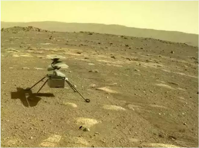 The First Color Photograph Of NASA's Ingenuity Chopper From Mars