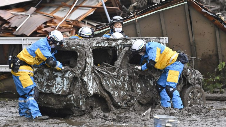 'This is hell': 1,500 rescuers search mud for Japan missing