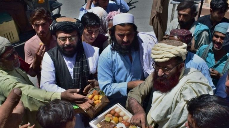 Islamist groups in Pakistan distribute sweets to 'celebrate' Taliban seige
