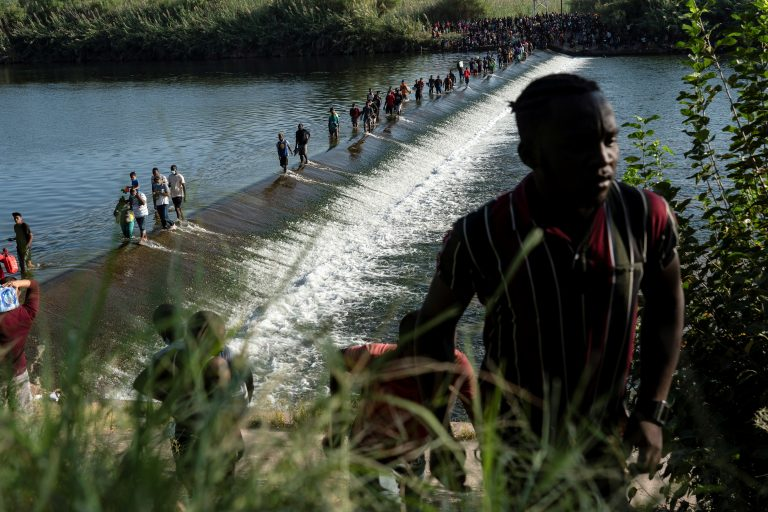 Over 10,000 mostly Haitian migrants sleeping under Texas bridge, more expected