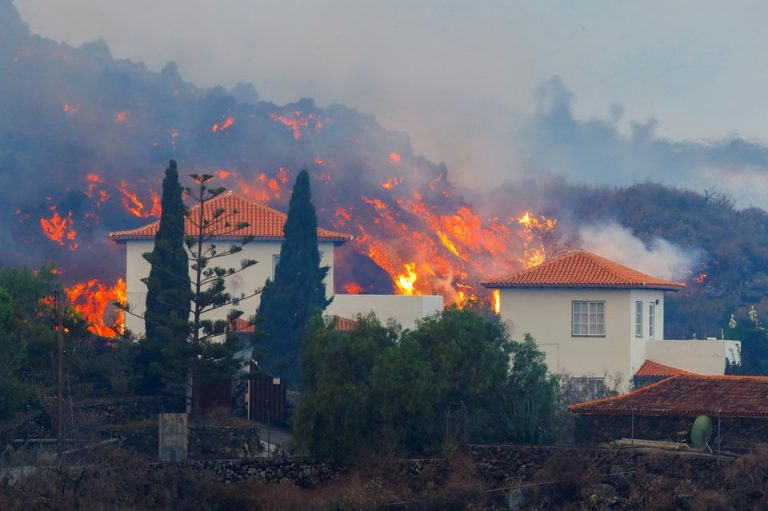 Thousands Flee As Lava Spewing From Volcano On Spain's La Palma Island Destroys Houses