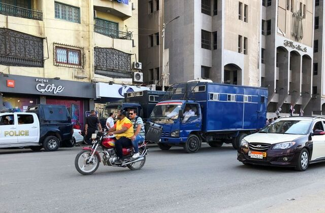 """""""Don't worry,"""" says jailed Egypt rights researcher as he is driven from court"""