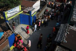 Midnight vigils, snaking queues as some Indians await COVID vaccines