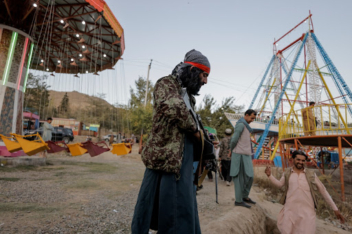 Battle-hardened Taliban fighters enjoy a day off at amusement park
